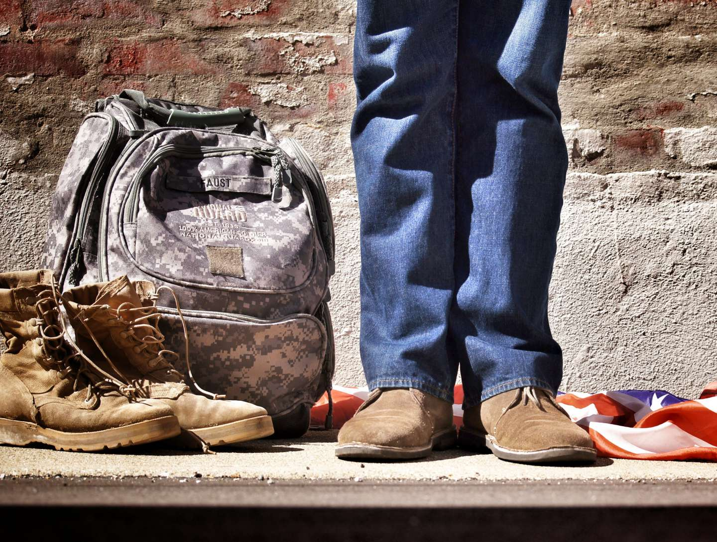 Military bag, boots, and American flag
