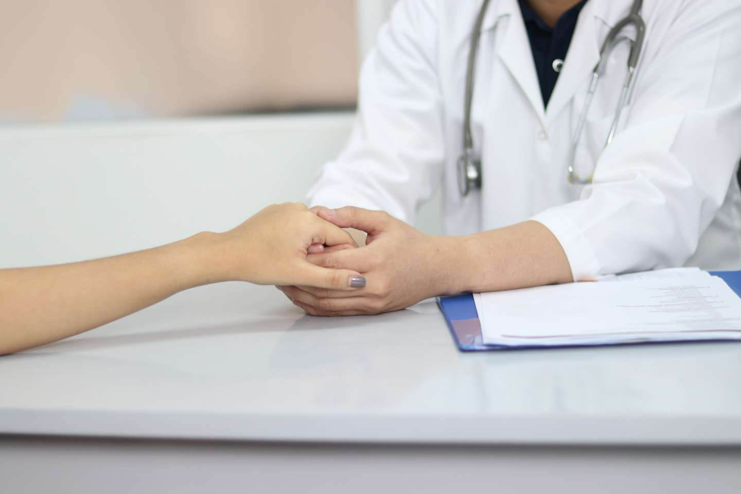 medical person holding hand of a woman