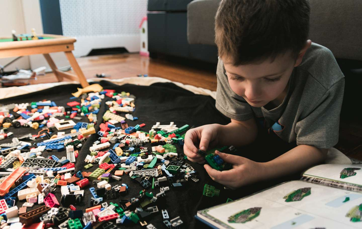 boy using instructions to build a toy