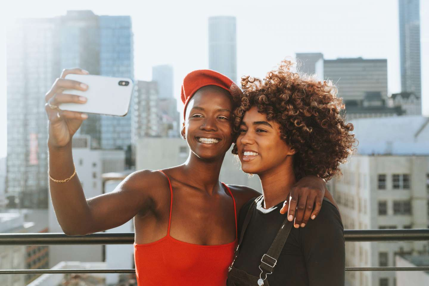 Two urban teenagers taking a selfie with a smart phone